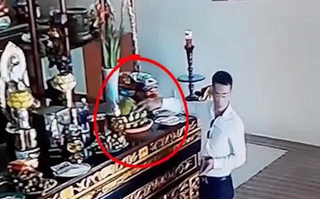 Xác minh người đàn ông ăn mặc bảnh bao vờ thắp hương để trộm tiền công đức trong chùa