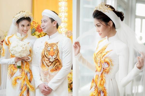 """Bóc giá """"khủng"""" bộ áo dài phượng hoàng được đính kết bằng tơ vàng của Lan Khuê trong lễ đính hôn"""
