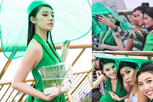 """Jolie Nguyễn """"chiếm sóng"""" với chiếc mũ khổng lồ che mưa 3 người còn vừa và chiếc túi nhựa trong suốt, thả được cả đàn cá bơi lội"""