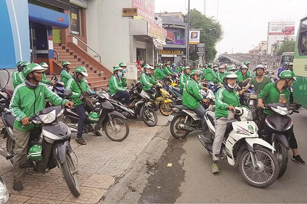 Grab tuyên bố không trả nợ thuế ở Việt Nam thay Uber, luật sư nói như vậy không đúng pháp luật